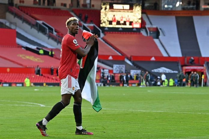 Man Utd star Paul Pogba carries Palestine flag around Old Trafford