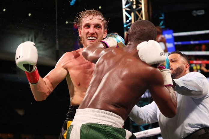 Logan Paul goes the distance with Floyd Mayweather Jr in boxing exhibition