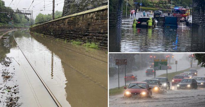 Freak storm in Edinburgh leaves shops and train tracks flooded